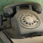 790018-old-dusty-rotary-dial-telephone-resting-on-a-table